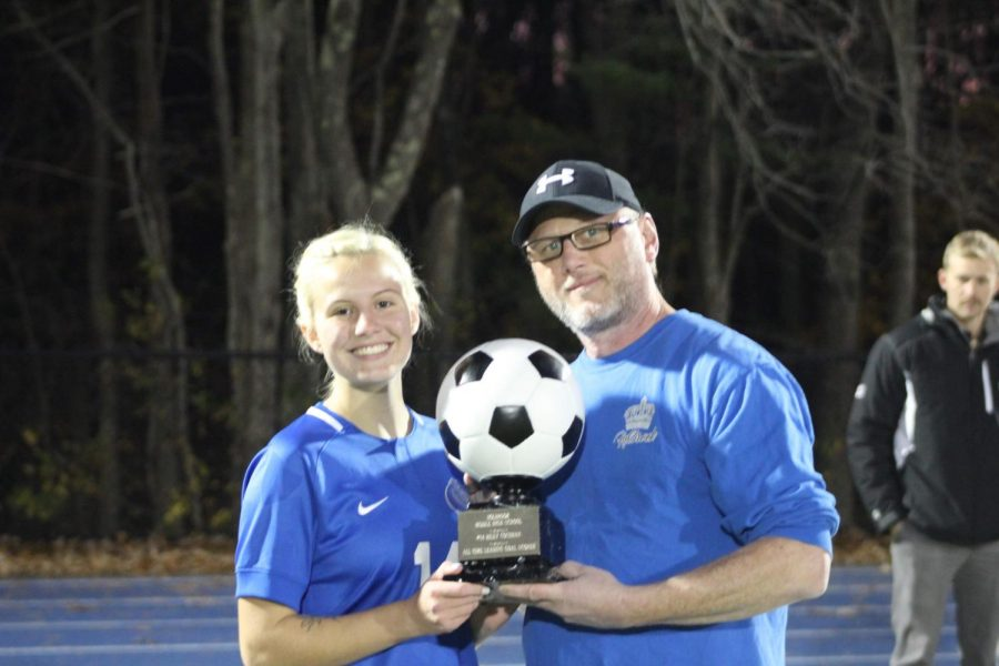 Coach Culpepper gives Riley trophy for her record breaking goal.
