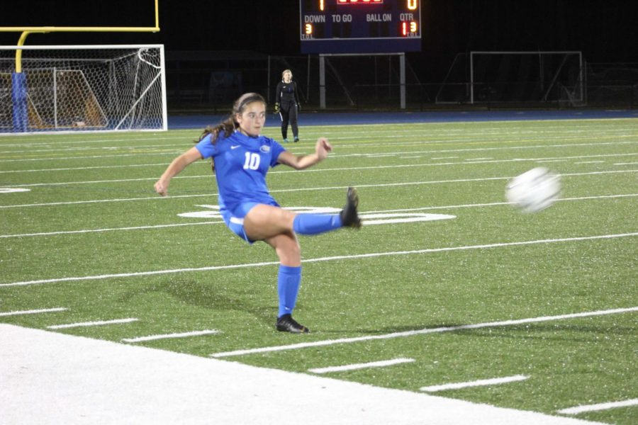 Emma Pepe kicks the ball.