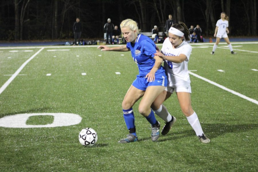 Riley Cochran keeps ball away from opponent.