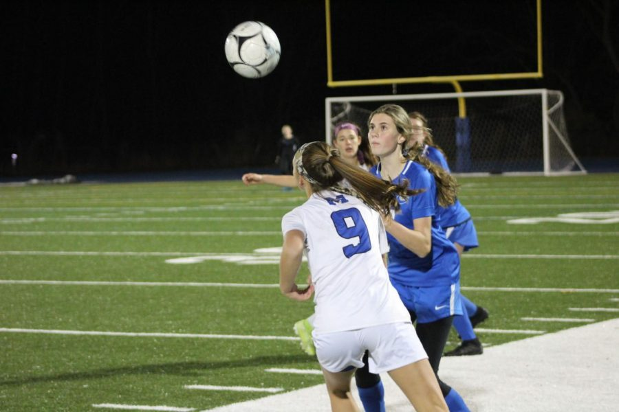 Emily Cochran fights for the ball
