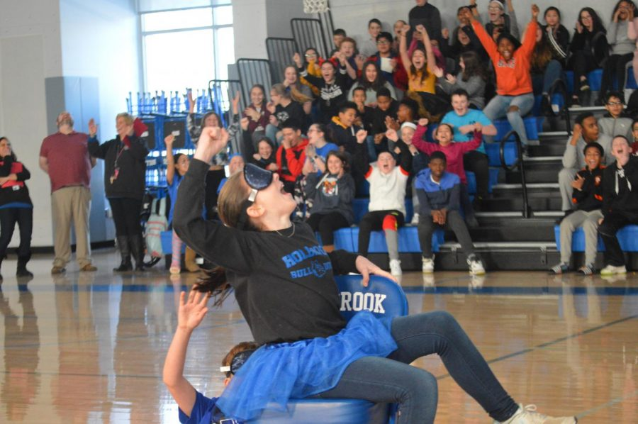Allyson Johnson strives to win in musical chairs with her fellow 6th graders cheering her on.