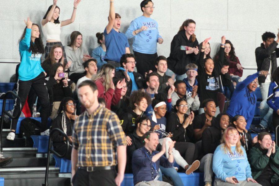 Students cheer during the three point shot contest.