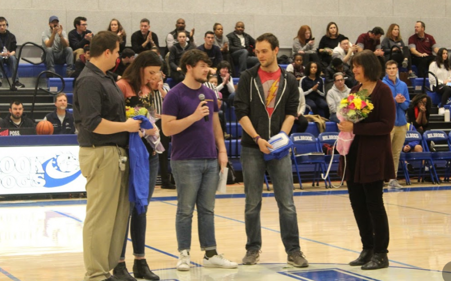 David Walsh presents gifts to the Monteith family