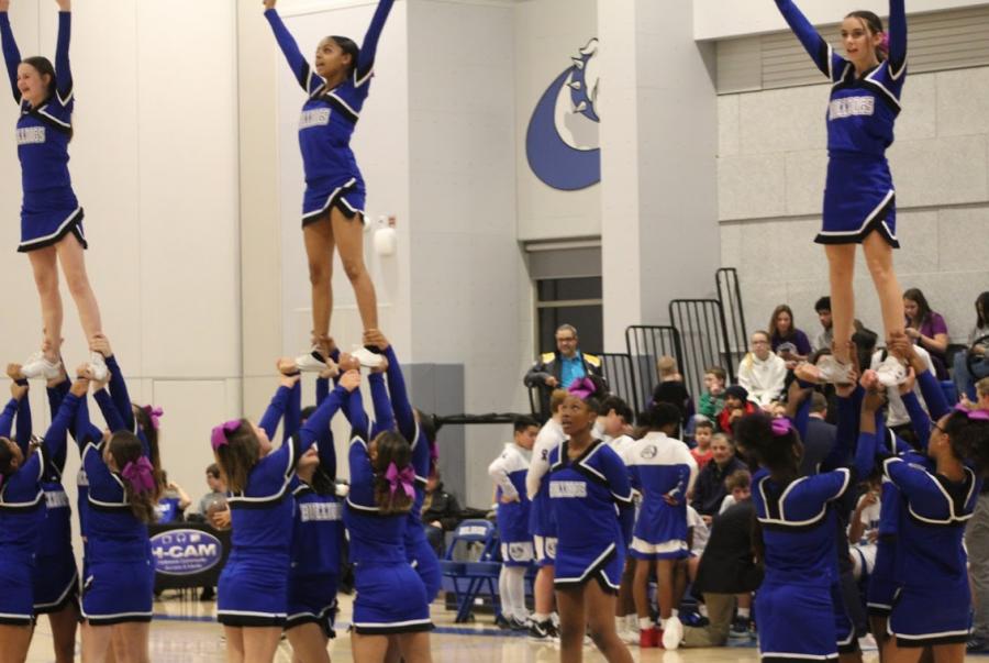 The cheerleaders perform at halftime.