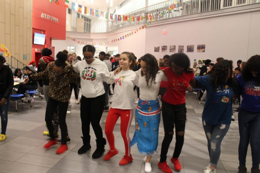 Students dance at the culture fair.