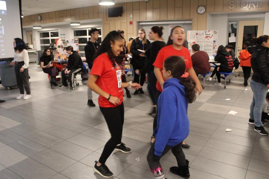 Dalice Rodriguez teaches Lorelei Fratecelli to dance.