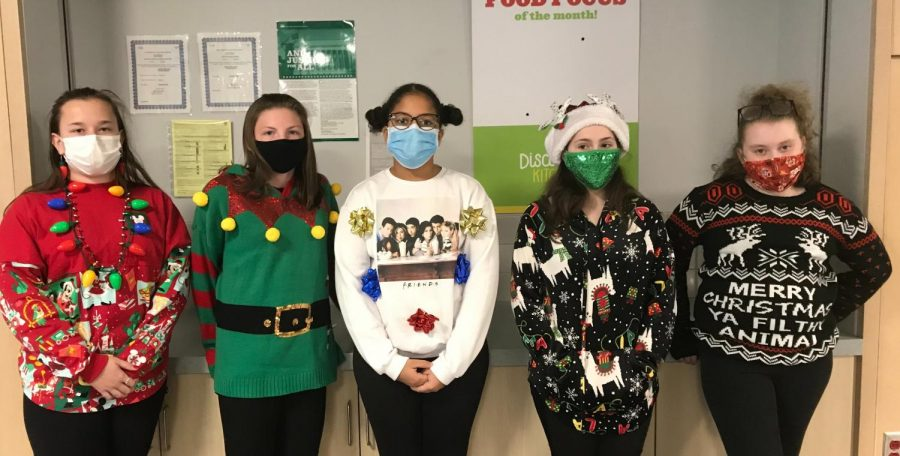 Ugly Sweater Day!  Sophee Bellew: Home alone sweater Shailash Haley:Lama Molly Chiocca:Light Bulb necklace Ayla Baptista:Sweater with bows Allyson Johnson:elf