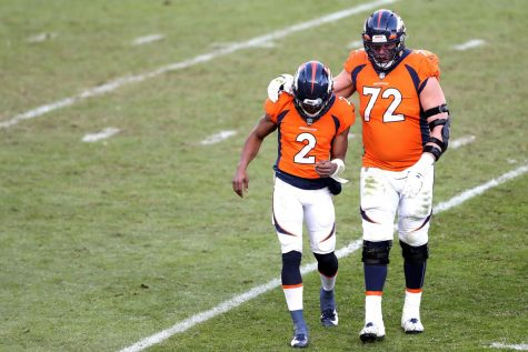 Denver Broncos emergency Quarterback Kendall Hilton (#2) walks off the field after throwing an interception.