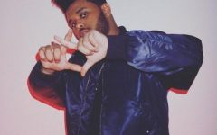 Abel holding up XO, repping his label.